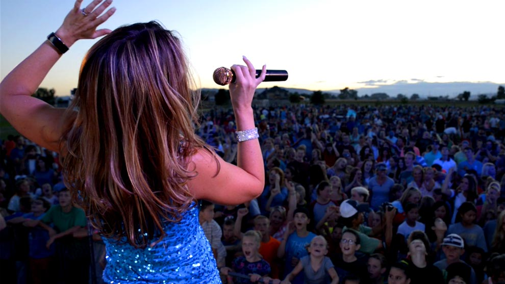 Lead Singer of No Limits Playing to a Large Crowd