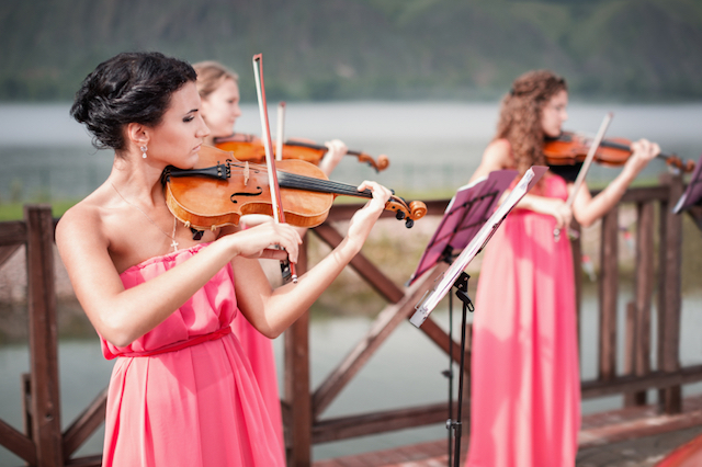 Girls Playing Violins at an Outdoor Wedding