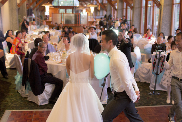 Bride and Groom Playing a Wedding Game