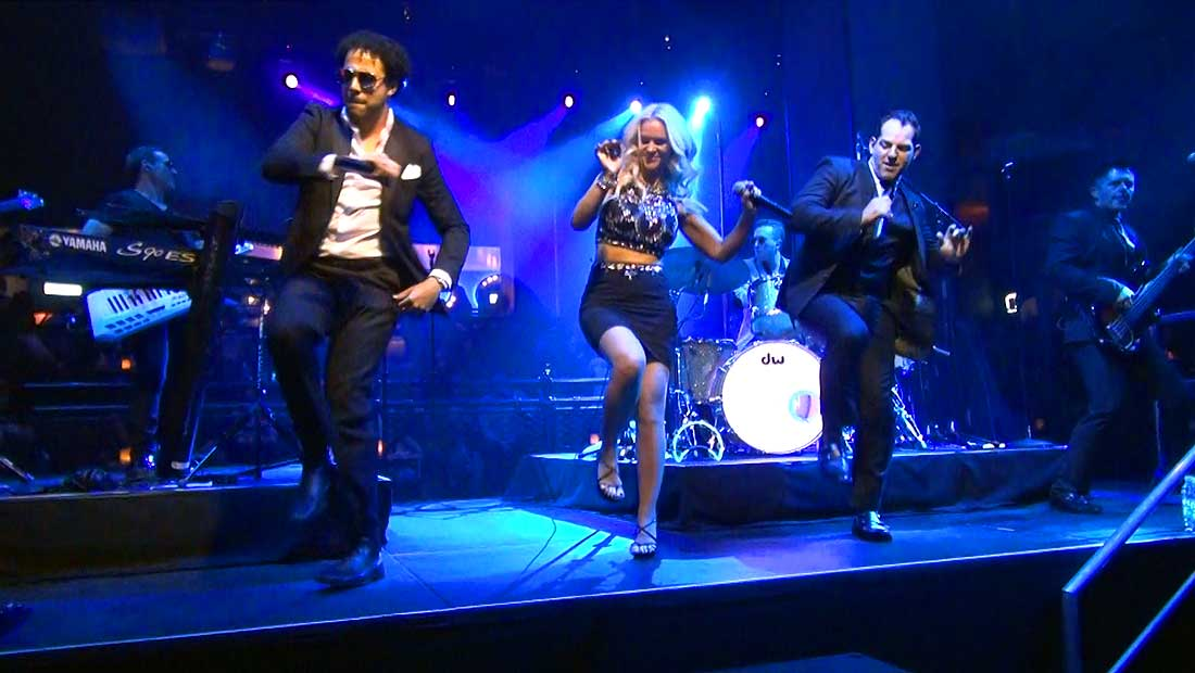 Party Crashers Band Vocalists Singing and Dancing